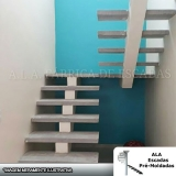 loja de escada em u com viga central Mauá